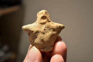 An extremely Rare and totally intact Early Neolithic hand modelled clay mother Goddess votive figurine. SOLD